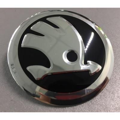 Аксессуары Наклейка на диск Skoda (New) D56 мм алюминий, выпуклый (Новый серебристый логотип на черном фоне)